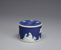 Inkwell of white jasper with dark blue jasper dip and white relief decoration, the body with scenes from the Domestic Employment series in a landscape, the top with a large opening in the center and four smaller openings, three with white relief stiff leaf motifs around them.