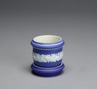 Miniature cache, or flower, pot of white jasper with dark blue jasper dip and white relief decoration, the pot of bulbous shape with slight foot and bands of white at top and bottom, in the center of the body a large floral band in white relief.