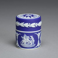 Miniature round box or container with cover of white jasper with dark blue jasper dip and white relief decoration, the body with three small relief scenes including The Muses Watering Pegasus, Bellerophon Watering Pegasus, and Ulysses Staying the Chariot of Victory, the cover with a band of lotus leaves around the edge and on top a pattern of acanthus leaves with a floral motif in the center.