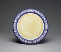 Stand for a cheese dome, on raised foot, of white jasper with dark blue jasper dip and white relief decoration of a border of oak leaves and acorns between two white bands, the white jasper discolored and the stand is missing its cheese dome.