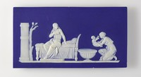 """Rectangular plaque of white jasper with dark blue jasper dip on the front and the back, on the front in white relief the scene of """"Birth of Achilles"""" with Achilles mother seated on a daybed and her attendant preparing to baptize Achilles with a font."""