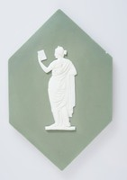 """Large hexagonal plaque of white jasper with dark green jasper dip and white relief decoration of Iphigenia holding a letter, adapted from the tablet """"Orestes and Pylades,"""" the plaque probably designed for a fireplace surround."""