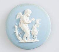Round blue jasper medallion with white relief of sacrificial scene with winged boy, set in metal frame