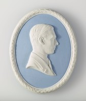 Oval blue jasper medallion with white relief profile portrait of King George VI, with white laurel leaf border