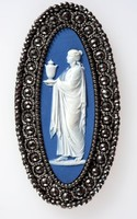 Oval blue jasper cameo with white relief of sacrificial figure, set in cut steel mount, metal components possibly by Matthew Boulton. the cut steel shows multi facets designed to imitate gemstones