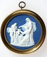 Round dark blue jasper medallion with white relief scene of Cupid unmasked also known as Cupid as Oracle. In his role as God of Love Cupid is divining the future for the assembled maidens, set in brass frame with ring