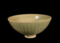 Bowl with carved lotus-petal exterior, brown wash on base.