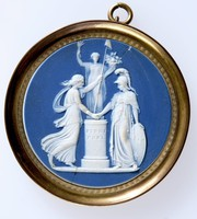 Round dark blue jasper medallion with white relief of France and Liberty joining hands before a statue of plenty..  set in brass mount with ring