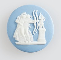 Round blue jasper cameo with white relief scene of archers, set with millefiori mosaic glass surround in metal frame