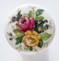 Drawer pull with enameled floral decoration