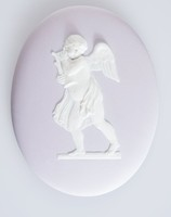 Oval light lilac jasper medallion with white relief of putto with lyre Eros