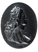 Oval black basalt medallion with relief profile portrait of William III (1650-1702)  facing right, William III was the King of England, Scotland and Ireland. Son of William II of Orange and Mary daugher of Charles I. the English Princess Royal. As a Protestant, William III participated in several wars against the powerful Catholic king of France, Louis XIV, in coalition with Protestant and Catholic powers in Europe. When James II attempted to restore the Roman Catholic religion, alienated his people, William and his wife were invited to take his place. William landed near Torbay in 1688 and James quickly fled to France where he sought protection of Louis XIV.