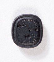 """Rectangular black basalt intaglio with Cupid and earth(?) on scales, inscribed """"L'AMOUR L'EMPORTE(?)"""" (""""Love Prevails""""?)"""