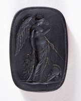 Rectangular black basalt intaglio with winged female with arms of deceased warrior