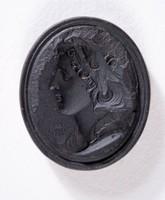 Oval black basalt intaglio with profile portrait