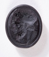 Oval black basalt intaglio with double profile of warrior and woman?