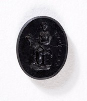 Oval black basalt intaglio with figure of Calliope