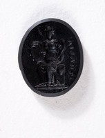 Oval black basalt intaglio with figure of Thalia