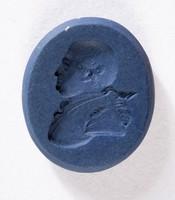 Oval very dark blue jasper intaglio with profile portrait of a man