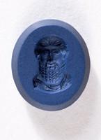Oval dark blue jasper intaglio with portrait of man's head