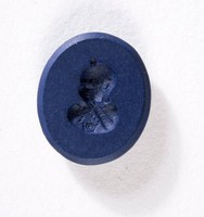 Oval dark blue jasper intaglio with portrait of child's or dwarf's head?