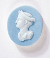Oval blue jasper cameo with white relief profile portrait of a woman