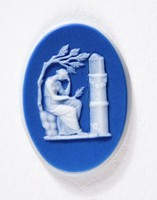 Oval dark blue jasper cameo with white relief scene of seated woman