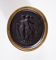 Oval black basalt intaglio with the Three Graces, mounted in pinchbeck shank