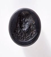 Oval self-shanked black basalt intaglio with portrait of Benjamin Franklin