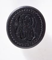 "Oval self-shanked black basalt intaglio or cypher seal, ""E B"""