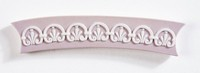 Curved bar-shaped pink jasper cameo with white relief decoration