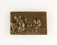 Rectangular brass plaque with relief of three putti