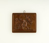 Rectangular bronze plaque with relief scene of woman reclining on bed with man holding baby kneeling beside her, with winged female overhead