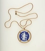 Round dark blue jasper cameo with white relief of Venus and Cupid, set in gold metal as a pendant with chain necklace