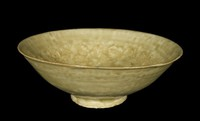 Bowl with olive glaze with molded pattern of three boys playing amidst flowers