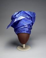 Head-wrap of blue fabric with metallic thread