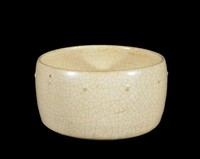 Bowl with a simple row of bosses for decoration.