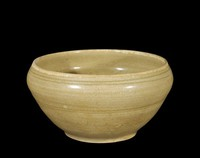 Bowl with inverted rim, with olive glaze with incised floral motifs on interior and faint cloud motifs on exterior, and five spurmarks in well