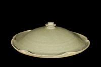 Cover for bowl with celadon glaze, rolled lotus-leaf edge, incised petals under glaze