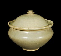 Bowl and cover with celadon glaze, bowl with incised lotus in well and floral pattern on interior walls, with petals on exterior, cover with incised petals around central knob, and scalloped edge.