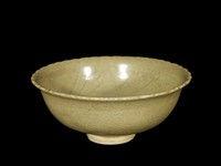 Bowl wtih scalloped rim, with celadon glaze and chocolate base, with incised whorl pattern and firing ring in well, with jade-like exterior.