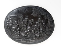 Oval basalt plaque with nine Bacchanalian boys at play in a vineyard