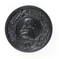 Round black basalt medallion with profile portrait of John Wesley 1703-1791 facing right, in custom leather box