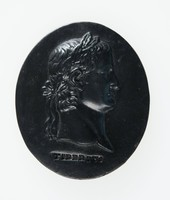 Oval black medallion with profile portrait of Tiberius facing right