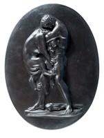 Oval basalt plaque of Hercules strangling the Nemean Lion