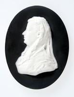 Oval black jasper medallion with white relief profile portrait of Baroness Mayer de Rothschild facing left