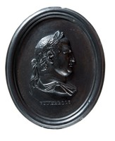 Oval black basalt medallion with relief profile portrait of Vitellius (15 AD - 69 AD) facing right. Aulus Vitellius was a Roman Emperor reigning for 8 months between 16th April AD 69 and 22nd December AD 69 before being assasinated. Vitellius was quickly proclaimed emperor after the quick succession of the previous emperors Galba and Otho.