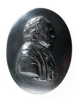 Oval portrait medallion of black basalt with relief profile depicting of Mr. Bourne, bricklayer at Etruria.