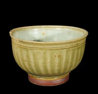 Cup with everted rim and carved ribbing, with green exterior glaze, blue-green interior glaze, green glaze on bottom and brown wash on exterior of foot-ring