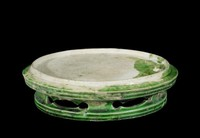 Stand with carved cut base, lead-green glaze.